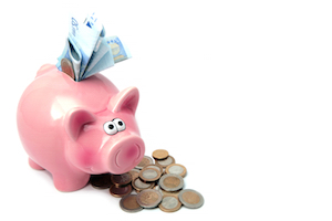 Piggy Bank Stuffed With Money And Surrounded By Coins.
