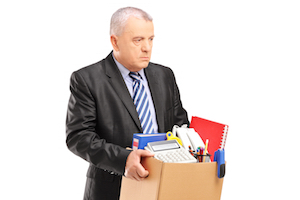 A fired professional man with a box of belongings, isolated on w